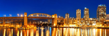 bc: Vancouver False Creek at night with bridge and boat panorama.