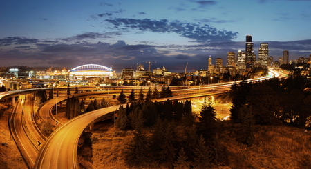 city buildings: Seattle city view with urban architecture and traffic light trail.
