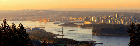 bc: Vancouver sunrise with Lions Gate Bridge and skyscrapers in Canada. Stock Photo