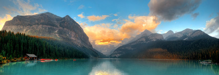 louise: Banff national park Lake Louise sunrise panorama with mountains and forest in Canada. Stock Photo