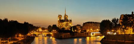 notre dame de paris: Notre Dame de Paris at dusk panorama over River Seine as the famous city landmark.