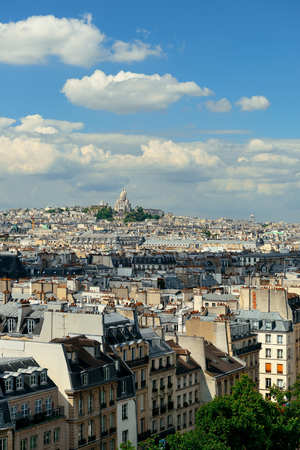 coeur: Paris rooftop view with Sacre Coeur and city skyline.