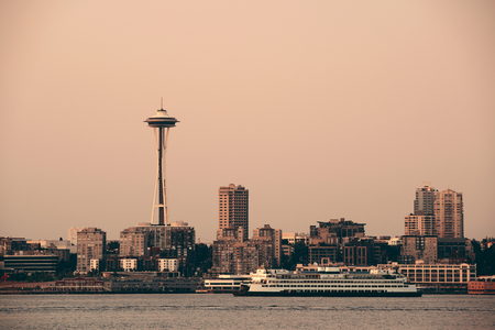 space needle: Seattle city skyline view over sea with urban architecture and Space Needle.