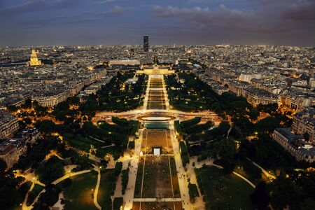 aerial: Paris city skyline rooftop view at night, France. Stock Photo
