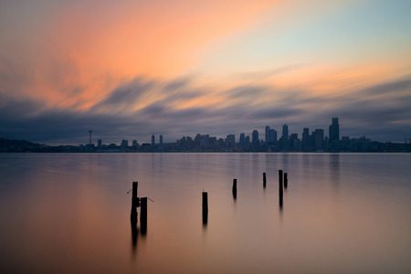 sea view: Seattle city skyline view with abandoned pier over sea with urban architecture. Stock Photo