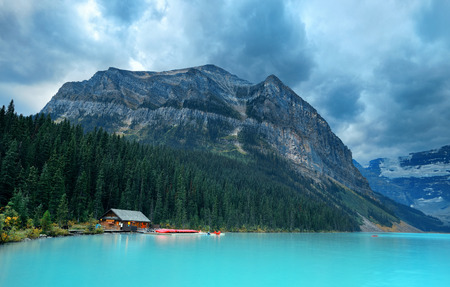louise: Lake Louise in Banff national park with mountains and forest in Canada. Stock Photo