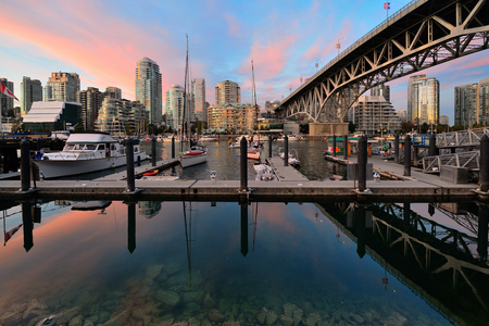 metropolis: Vancouver False Creek at sunset with bridge and boat.