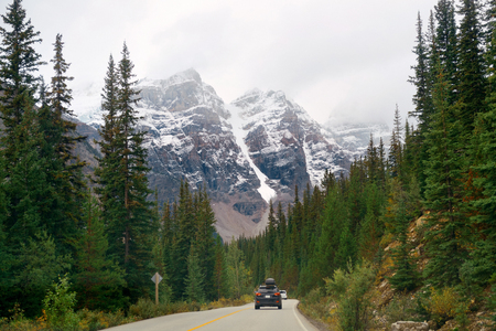 snow capped mountain: Snow capped mountain of Banff National Park and highway in Canada Stock Photo