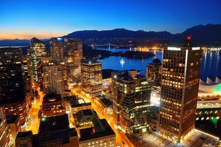 metropolis: Vancouver rooftop view with urban architectures at dusk.