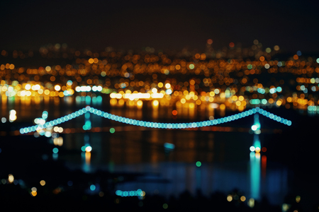 bc: Vancouver city night view bokeh with buildings and bridge.