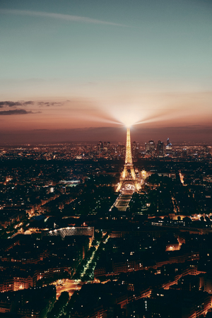 steel tower: PARIS, FRANCE - MAY 13: Eiffel Tower and city at night on May 13, 2015 in Paris. It is the most-visited paid monument in the world with annual 250M visitors.