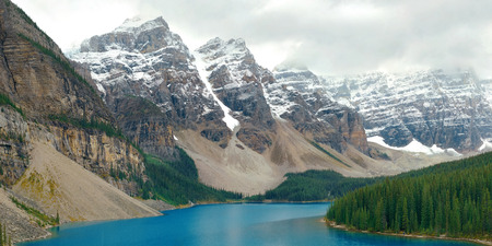 capped: Moraine Lake with snow capped mountain of Banff National Park in Canada