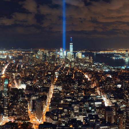 tribute: New York City downtown skyline night view and 911 tribute light. Stock Photo