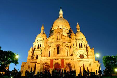 night dusk: Sacre Coeur Cathedral at dusk in Paris, France.