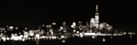 wtc: New York City downtown skyline out of focus bokeh panorama at night