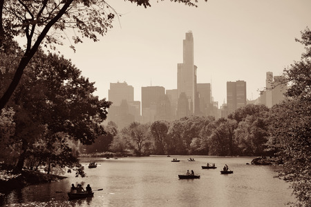 boating: People boating in lake in Central Park in Autumn New York City Stock Photo
