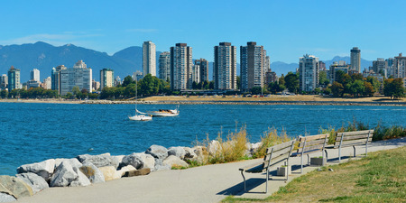 city park skyline: Vancouver city skyline at waterfront with bench in park