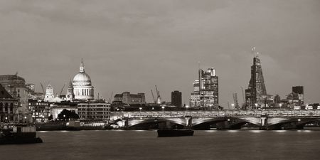 st pauls: London skyline at night with bridge and St Pauls Cathedral over Thames River. Stock Photo