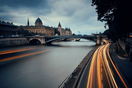 light trail: River Seine with bridge and traffic light trail Stock Photo
