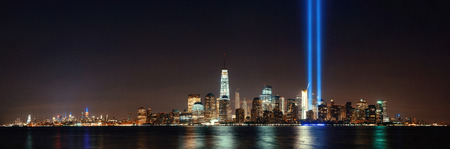 hudson river: New York City downtown skyline at night panorama over Hudson River and September 11 tribute light Stock Photo