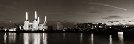 battersea: Battersea Power Station panorama over Thames river as the famous London landmark at night. Stock Photo