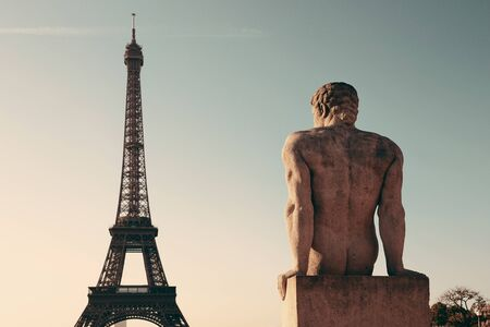 sculpture: Eiffel Tower with statue as the famous city landmark in Paris