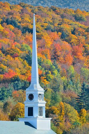 autumn landscape: Stowe in Autumn with colorful foliage and community church in Vermont