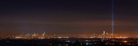 New York City skyline at night panorama and September 11 tribute light Stock Photo