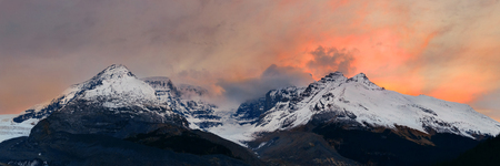 canadian rockies: Columbia Icefield panorama with snow covered mountains at sunrise in Banff Jasper National Park, Canada.