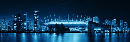 ethnically diverse: VANCOUVER, BC - AUG 17: BC Place Stadium at night with city buildings on August 17, 2015 in Vancouver, Canada. With 603k population, it is one of the most ethnically diverse cities in Canada.