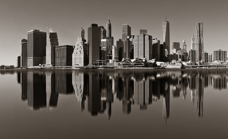 wtc: Manhattan financial district with skyscrapers over East River with reflection. Stock Photo