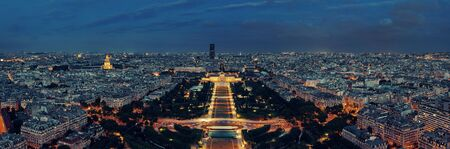 Paris city skyline rooftop view at night, France. Stock Photo