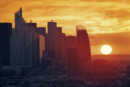 sunset city: Paris sunset rooftop sunset view of the city skyline with la Defense business district in France.