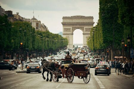 shopping carriage: PARIS, FRANCE - MAY 13: street view and Arc de Triomphe on May 13, 2015 in Paris. With the population of 2M, Paris is the capital and most-populous city of France