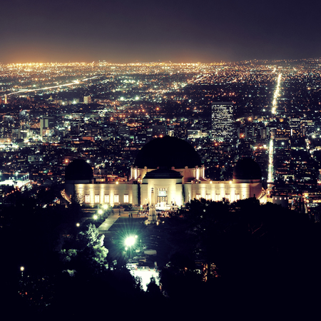 observatory: Los Angeles at night with urban buildings and Griffith Observatory Stock Photo