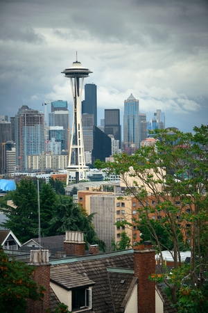 in wa: SEATTLE, WA - AUG 14: Space Needle and city downtown on August 14, 2015 in Seattle. Seattle is the largest city in both the State of Washington and the Pacific Northwest region of North America