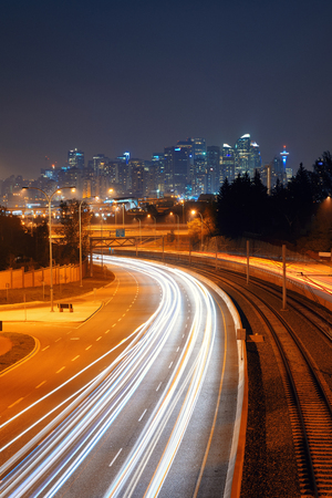 traffic building: Calgary downtown with light trails at night, Canada. Stock Photo