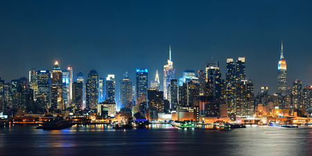 Midtown Manhattan skyline at dusk panorama over Hudson River Stock Photo