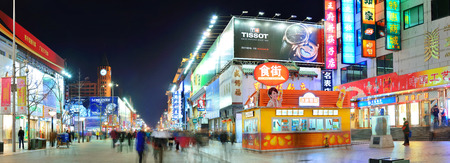 BEIJING, CHINA - APR 1: Wangfujing commercial street at night on April 1, 2013 in Beijing. It is one of the most famous shopping streets in the capital and the host of 280 famous Beijing brands stores Imagens