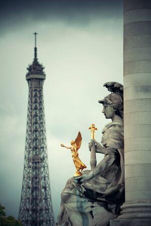 iii: Statue of Alexandre III bridge over River Seine with Eiffel Tower in Paris, France.