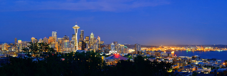 space needle: Seattle city skyline at night with urban office buildings viewed from Kerry Park. Stock Photo