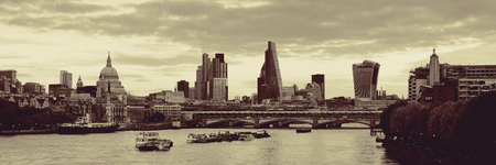 british english: London cityscape panorama with urban buildings over Thames River
