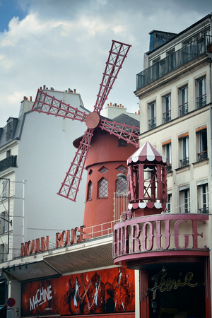 moulin: PARIS, FRANCE - MAY 13: Moulin Rouge and street view on May 13, 2015 in Paris. It is the most-visited paid monument in the world with annual 250M visitors. Editorial