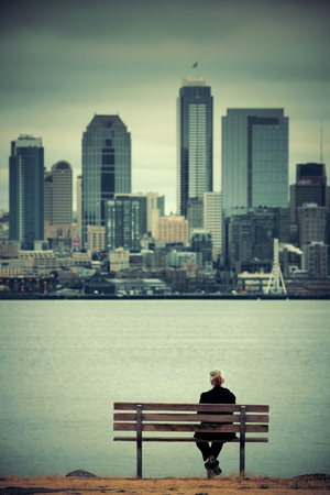 state of mood: A lady rest at waterfront with Seattle city skyline