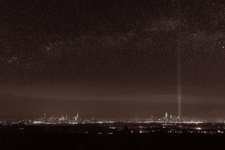 september 11: New York City skyline at night with star milkyway and September 11 tribute light