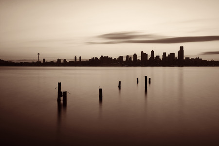 waterfront: Seattle sunrise skyline silhouette view with urban office buildings. Stock Photo