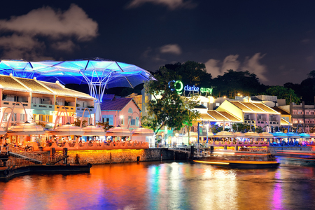 singaporean: SINGAPORE - APR 5: Clarke Quay at night with street view and restaurant on April 5, 2013 in Singapore. As a historical riverside quay, it is now the hub of Singaporean nightclubs. Editorial