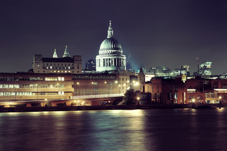 english famous: St Pauls Cathedral over Thames River at night in London. Stock Photo