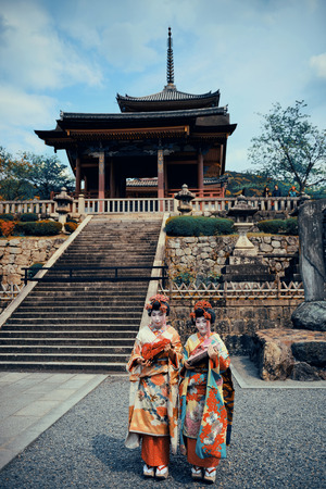 buliding: KYOTO, JAPAN - MAY 18: Geisha stand in Shrine on May 18, 2013 in Kyoto. Former imperial capital of Japan for more than one thousand years, it has the name of City of Ten Thousand Shrines.