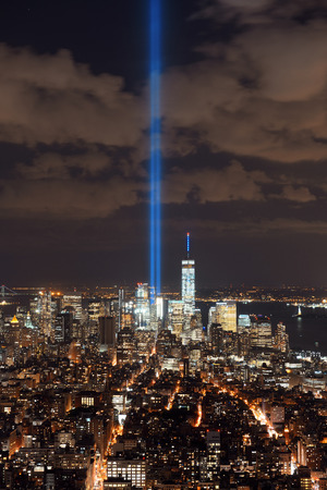 september 11: New York City downtown skyline view at night with September 11 tribute light. Stock Photo